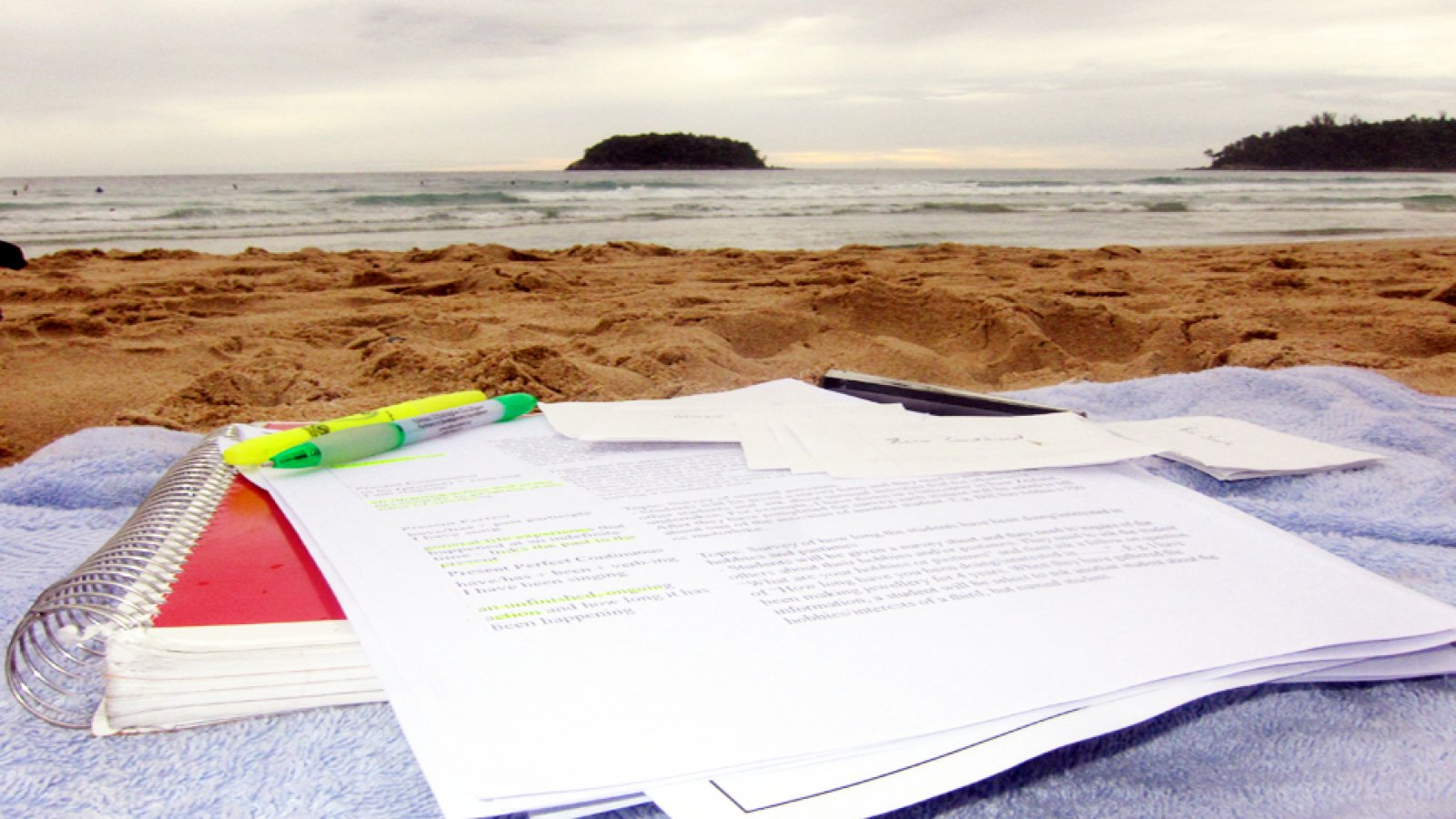 study materials at the beach